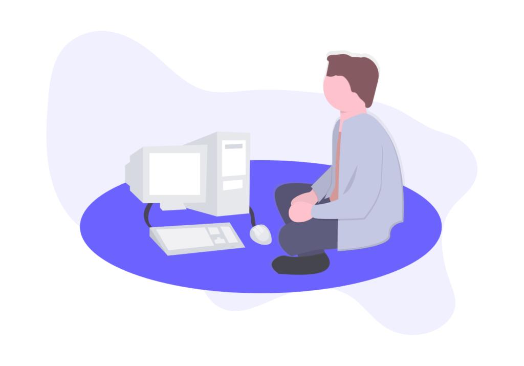パソコンの前で座る人