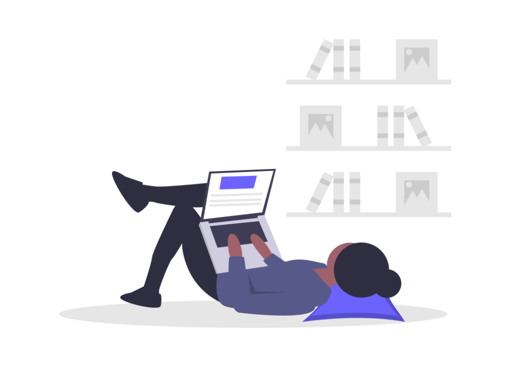 寝転びながらパソコンをする人