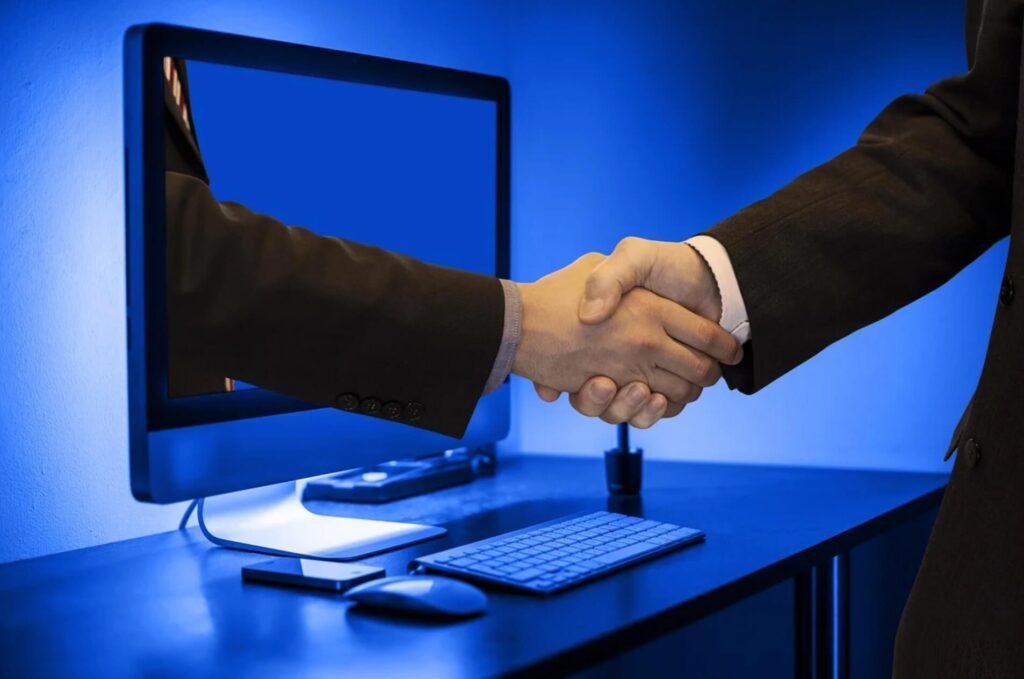 画面越し 握手
