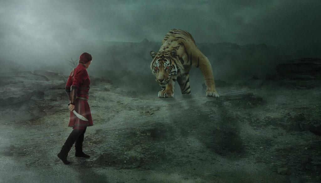 トラに立ち向かう人