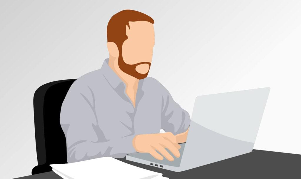 PCの画面を見る男性